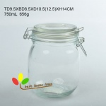 Glass jar with colorful clips