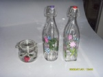Glass milk bottle with hand painted design